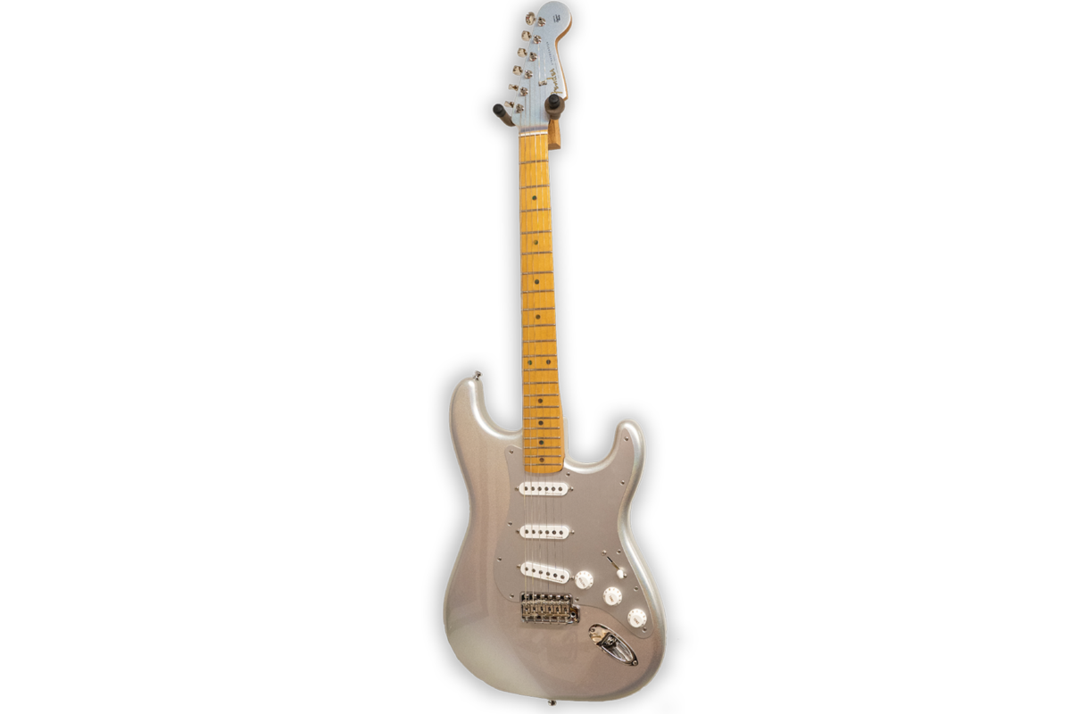 H.E.R. Electric Guitar, c. 2021 Fender H.E.R. Stratocaster Courtesy of H.E.R. . The H.E.R. Signature Stratocaster® was designed to the artist's specifications with a distinctive look and exceptional tone; it features Fender Vintage Noiseless™ pickups, a 1-ply anodized aluminum pickguard and an alder body finished in stunning Chrome Glow inspired by her favorite nail polish color.