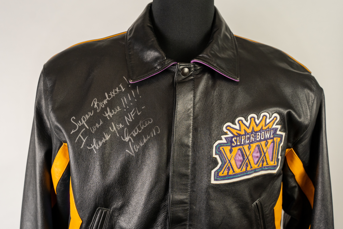 """Luther Vandross Jacket, 1997. Design by Carl Banks, Collection of the Pro Football Hall of Fame. Luther Vandross wore this jacket while performing the National Anthem at Super Bowl XXXI. Rolling Stone lauded Vandross' National Anthem performance as one of the best of all time, noting that he """"put a tiny bit of swing into"""" it."""
